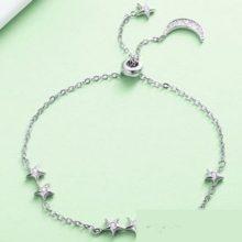 Holddal és csillagokkal díszített ezüst teniszkarkötő (Pandora stílus)