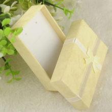 Ékszerdoboz masnival, papírból, sárga